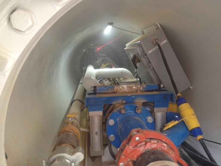 IVAC material transfer system in tunnel with visible laser level