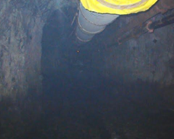 industrial pipe and hosing going down into a mine ventilation shaft