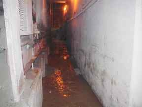 underground walkway beside a conveyor belt that is cleaned after an IVAC unit was used to pump out the materials