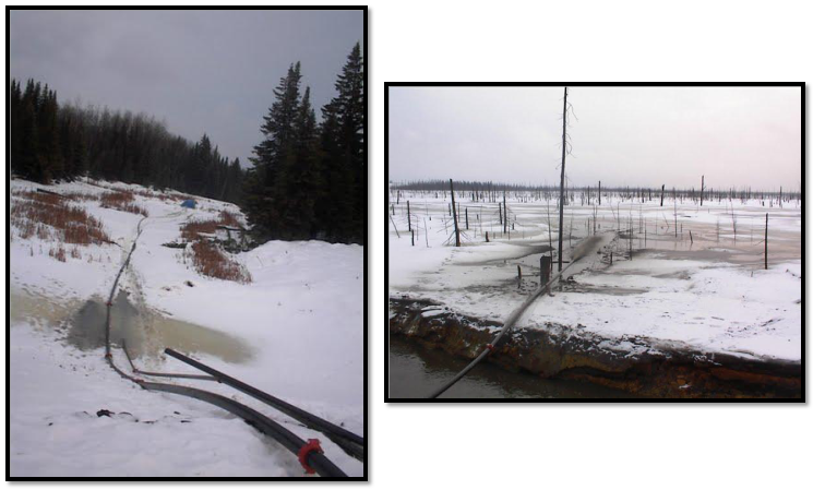 winter scene showing hose configuration for discharge of tailings