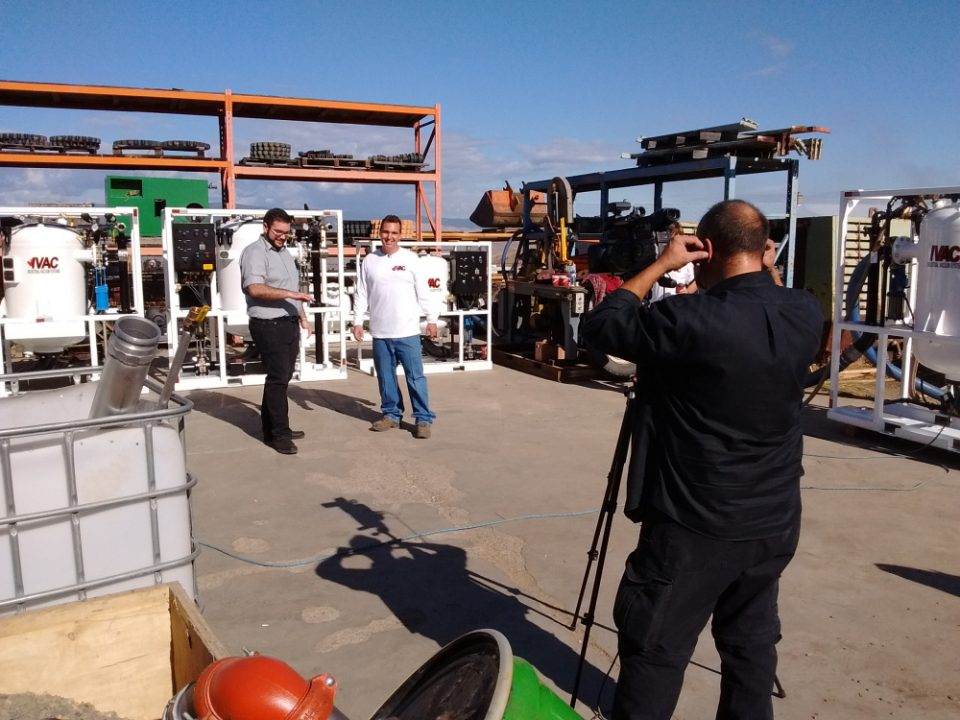 worker and interviewer during commercial filming