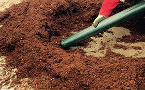 industrial hose pumping dirt and dry materials