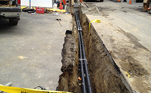 underground piping exposed during civil construction project