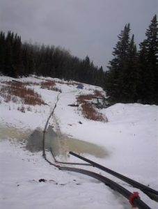 hard pipe configuration for material discharge in snow