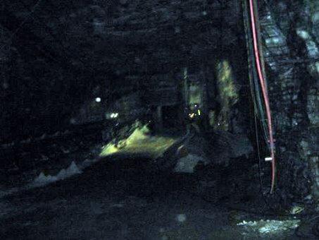 underground mine rock face and tunnel