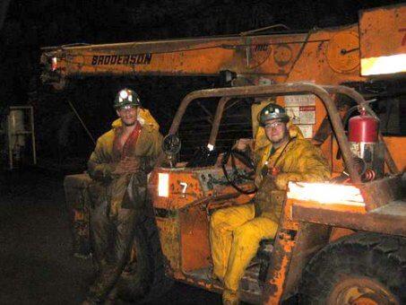 underground miners on scoop tram