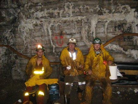underground miners wearing safety equipment