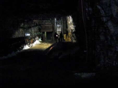 underground mine with workers by drill shaft