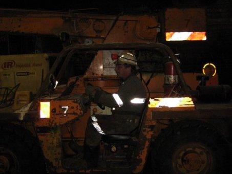 miner driving scoop tram