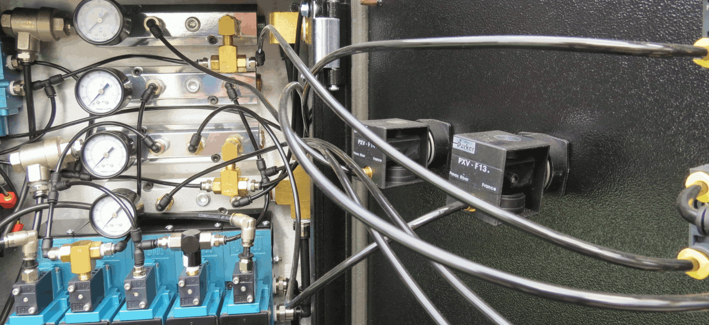 pneumatic control panel showing gauges and air hose