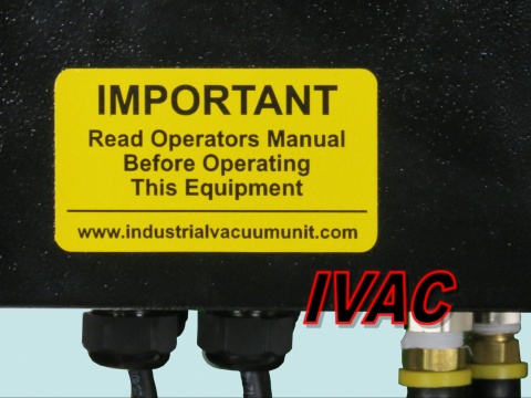 industrial vacuum control panel with warning decal